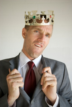 cocky-businessman-wears-crown-smll1.jpg